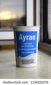 """VIENNA, AUSTRIA - JULY 17, 2018: Turkish yogurt drink ayran in a package. Translation of the text: """"Ayran, Turkish style yogurt drink, shake well before opening"""", bought from the supermarket """"Penny""""."""