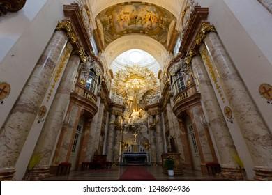 VIENNA, AUSTRIA - JULY 2018 : Altar at St. Charles Church, Karlsplatz in Vienna, Austria on July 15, 2018. Golden piece above altar symbolizing Yahweh,  national god of Israel