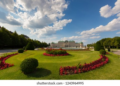 VIENNA, AUSTRIA - JULY 2018 : Beautiful garden in front of water basin and south facade of the Belvedere palace in Vienna, Austria on July 15, 2018