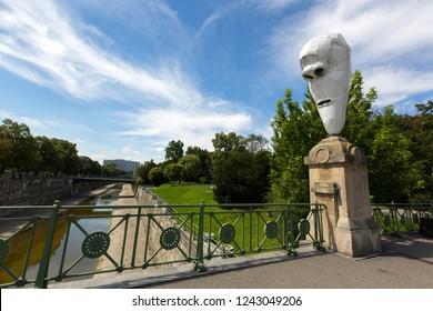 VIENNA, AUSTRIA - JULY 2018 : Lemurenkoepfe, One of the 4 Larvae, Lemur Heads by Franz West on the Stuben bridge named Stubenbruecke in Vienna, Austria on July 15, 2018