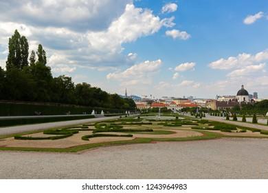 VIENNA, AUSTRIA - JULY 2018 : People sitting in garden at Belvedere palace in Vienna, Austria on July 15, 2018.