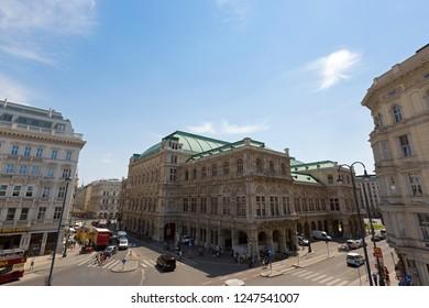 VIENNA, AUSTRIA - JULY 2018 : People walking in front of Vienna State Opera, named Wiener Staatsoper in Deutsch, Austrian opera house on Albertinaplatz in Vienna, Austria on July 17, 2018.