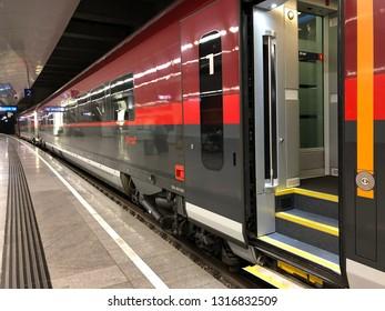 VIENNA, AUSTRIA - JULY 2018 : Railjet high speed rail service train arriving Flughafen Wien Bahnhof, Vienna Airport railway station in Vienna, Austria on July 27, 2018.