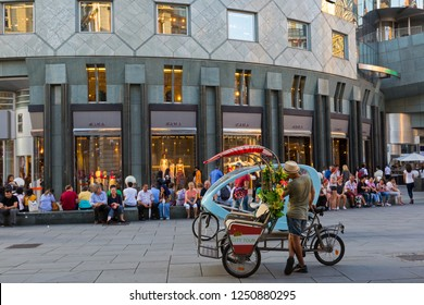 VIENNA, AUSTRIA - JULY 2018 : Taxi sightseeing tricycle vehicle wait for passengers on Stephansplatz, Vienna Inner City in Austria on July 16, 2018.
