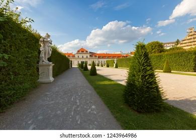 VIENNA, AUSTRIA - JULY 2018 : White statue in garden at lower Belvedere palace in Vienna, Austria on July 15, 2018.