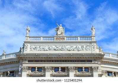 Vienna, Austria - July 23, 2017:View of Hofburgtheater, the Austrian National Theater on Volksgarten park in Vienna, Austria.