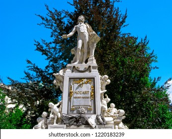 Vienna, Austria - July 24, 2018: Monument of Wolfgang Amadeus Mozart in Burggarten park. The monument was built in Baroque style from white marble. Mozart with a musical score, and around him angels.