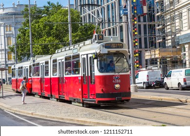 VIENNA, AUSTRIA - JULY 25, 2017: Traditional red electric tram in Vienna, Austria in a beautiful summer day