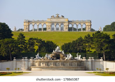 VIENNA, AUSTRIA - JULY 26,2013: View on Gloriette and Neptune fountain in Schonbrunn Palace. Schonbrunn main summer residence of Austrian emperors of a dynasty Gabsburg
