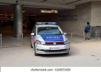 VIENNA, AUSTRIA - JULY 27, 2018: Austrian police car at the entrance of the Karlsplatz metro station.