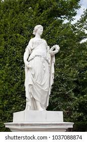 Vienna, Austria - July 7 2017: Schönbrunn palace park. A statue.