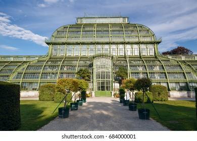 VIENNA, AUSTRIA - JULY 8, 2017. The Palmenhaus Schoenbrunn - a large greenhouse, opened in 1882 in the park Schoenbrunn in Vienna, Austria