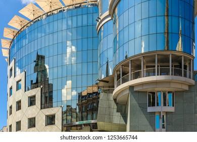 VIENNA, AUSTRIA - JUN 08, 2012 :   Beautiful reflections in the windows of the Haas Haus building on Stephansplatz, Vienna, Austria