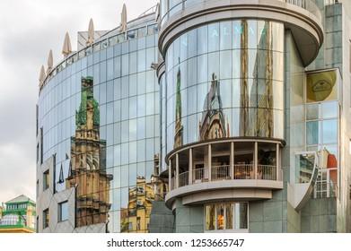 VIENNA, AUSTRIA - JUN 10, 2012 : Beautiful reflections in the windows of the Haas Haus building on Stephansplatz, Vienna, Austria