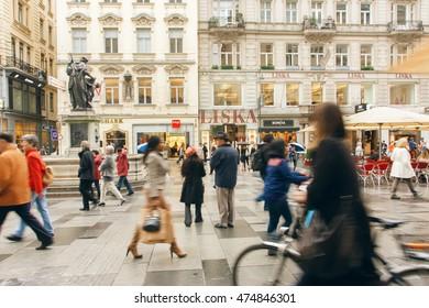 VIENNA, AUSTRIA - JUN 10: Crowd of business people and tourists rushing on old city street on June 10, 2016. Vienna has population near 1.8 million