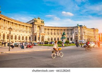 VIENNA, AUSTRIA - JUNE 04, 2017: Cyclists at Heldenplatz near of Famous Hofburg Palace