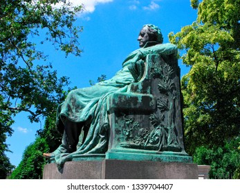 Vienna, Austria - June 11, 2018: Sculpture of Johann Wolfgang von Goethe on blue sky and surrounded by green trees. Goethe is German writer, thinker, philosopher and statesman.