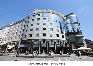 "VIENNA, AUSTRIA - JUNE 11, 2019: ""Haas-Haus"", an example of modern architecture in the city center of Vienna, across the main cathedral ""Stephansdom"". Designed by Hans Hollein. Opened in 1990."