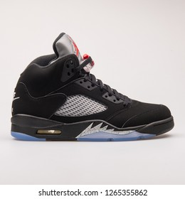VIENNA, AUSTRIA - JUNE 14, 2017: Nike Air Jordan 5 Retro OG black sneaker isolated on grey background