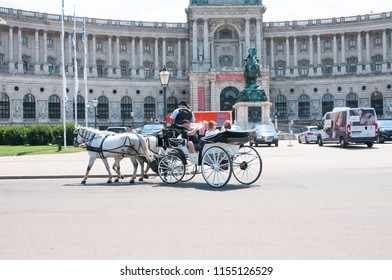 VIENNA, AUSTRIA - JUNE 17, 2018: Traditional old-fashioned fiacre at Heldenplatz near Hofburg
