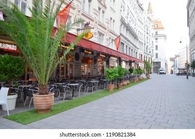VIENNA, AUSTRIA - JUNE 18, 2018: Open-air restaurant on city street