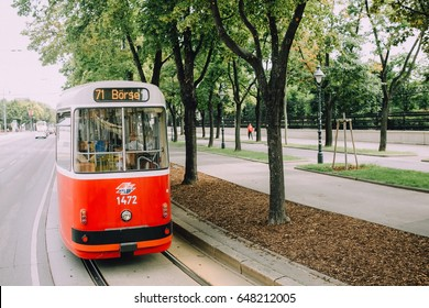 Vienna, Austria - June 2014. Red tram rides on the famous route Ringstrasse past the park
