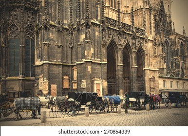 Vienna, Austria, June 26, 2013: horse-drawn carriages near the walls of St. Stephen's Cathedral. instagram image retro style