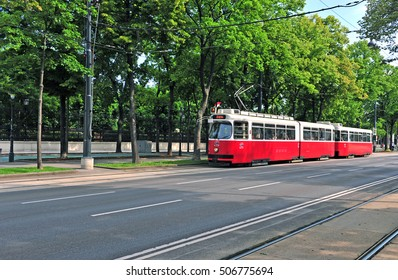 VIENNA, AUSTRIA - JUNE 6: Red classic tram goes by Ringstrasse street, Vienna on June 6, 2016. Vienna is a capital and largest city of Austria.