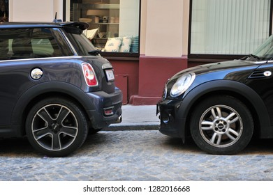 VIENNA, AUSTRIA - JUNE 6: Two cars parked in the street of Vienna on June 6, 2016.