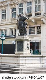 Vienna, Austria - June 74, 2014 - Sculpture of Saint Joseph (Josefsbrunnen) with Lion Fountain (Lowenbrunnen) on the northwestern end of the Graben