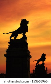 VIENNA, AUSTRIA - JUNE 9: Nussdorf weir with its lion statues silhouetted at sunset shown on 9 June 2011 in Vienna. The weir is a well known landmark by Otto Wagner, the lions are by Rudolf Weyr.