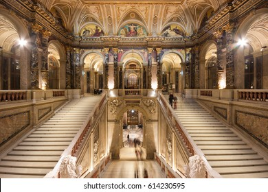 VIENNA, AUSTRIA - MARCH 15, 2017: Sumptuous staircase with Art Nouveau paintings in the interior of the Kunsthistorisches Museum in Vienna, Austria, during the Ganymed event.