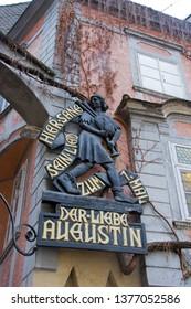 """VIENNA, AUSTRIA - MARCH 16, 2019: Neighborhood of Vienna's Innere Stadt Restaurant """"Der Liebe Augustin"""""""