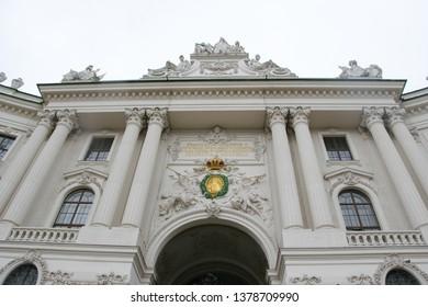 VIENNA, AUSTRIA - MARCH 16, 2019: St Michael Wing of Hofburg Palace on Michaelerplatz, Vienna