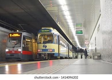 VIENNA, AUSTRIA - MARCH 16, 2019 - Wiener Linien ULF tram and the Wiener Lokalbahnen tram on suburban Badner Bahn route, at Kliebergasse underground tram stop