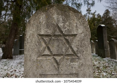 VIENNA, AUSTRIA - MARCH 18, 2018: Closeup of Star of David engraved on tombstone of Jewish section of Central Cemetery (Zentralfriedhof), one of greatest cemeteries in the world.