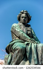 Vienna, Austria - March 2018: Sculpture of Ludwig van Beethoven in Vienna. Below is an ancient goddess with laurel wreath in hand