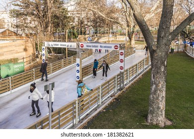 VIENNA, AUSTRIA - MARCH 8, 2014: Unidentified ice skaters at Wiener Eistraum (ice rink) near City Hall of Vienna (Rathaus). Every winter Rathausplatz is transformed into two connected 450 m2 ice rinks
