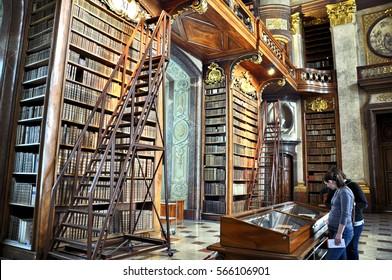 VIENNA, AUSTRIA - MAY 04, 2014: Old bookshelfs with ladder and books inside the Austrian National library. Tourist visit  exhibit.Vienna, Austria exhibit