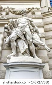 VIENNA, AUSTRIA - May 07 2013: Sculptural Composition Hercules and Cerberus, Hofburg in Vienna, Austria. Tourist attractions.