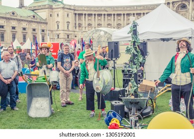 VIENNA, AUSTRIA, MAY, 2013: celebrations in Hofburg Imperial Palace park Vienna, Austria. The musician plays with scissors. Original performance.