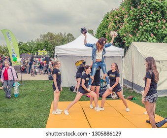 VIENNA, AUSTRIA, MAY, 2013: celebrations in Hofburg Imperial Palace park Vienna, Austria. Group of young girls cheerleaders are preparing for the performance