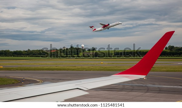 Vienna, Austria, May 2018: Austrian Airline airplane departing at the runway in Schwechat airport, photographed from another airplane