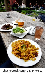 VIENNA, AUSTRIA - MAY, 2019:  typical foods and drinks in Glacis Beisl (Krautfleckerl mit grünem Salat) in downtown Vienna, Austria