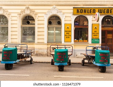 VIENNA, AUSTRIA - MAY, 22: Carts next to the shop of coal, wood and heating oil in Vienna on May 22, 2018