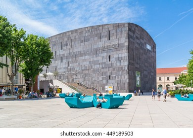 VIENNA, AUSTRIA - MAY 23, 2016: Museums Quartier square with people and modern art museum MUMOK in Vienna, Austria
