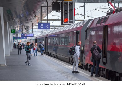 VIENNA, AUSTRIA - MAY 27: The passengers and accompanying on the platform on main railway station of Vienna (Wien Hauptbahnhof) Austrian railways (OBB), in Vienna, Austria, on May 27, 2019.