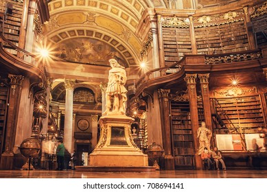 VIENNA, AUSTRIA - MAY 30: Interior of historical hall with sculptures and bookshelfs of Austrian National Library on May 30, 2016. Est in 18th century, largest library in Austria with 7.4 mill items