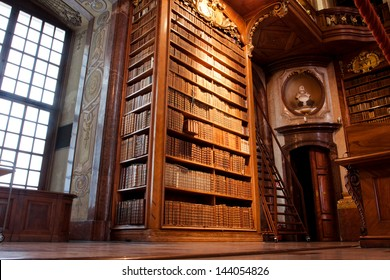 VIENNA, AUSTRIA - MAY 30: Old bookshelf with the books inside the beautiful Austrian National Library on May 30, 2013 in Vienna. Est in 18th century, the largest library in Austria with 7.4 mill items