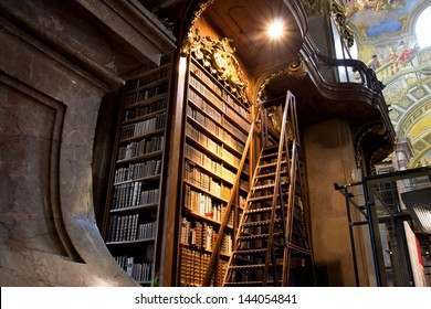 VIENNA, AUSTRIA - MAY 30: Stairs near the tall bookcase inside the great Austrian National Library on May 30, 2013 in Vienna. Est in 18th century, the largest library in Austria with 7.4 mill items